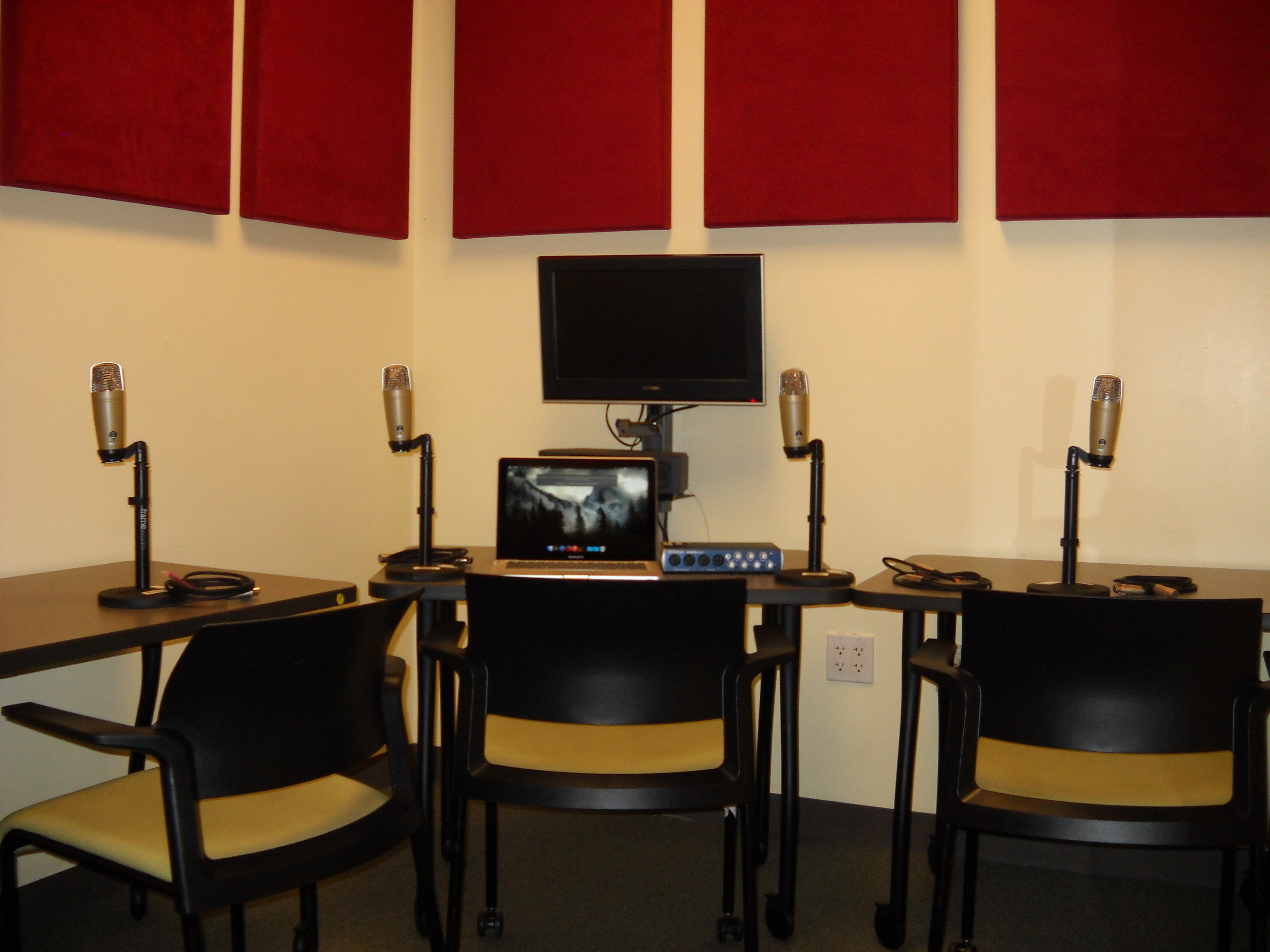 Image of room with chairs, computer monitor, and podcasting equipment