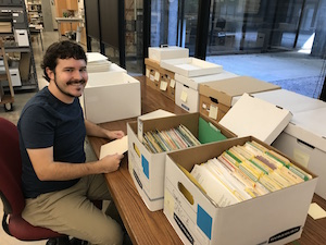 Jay Arms, 2017-2018 CART fellow, processing the organizational records of Other Minds