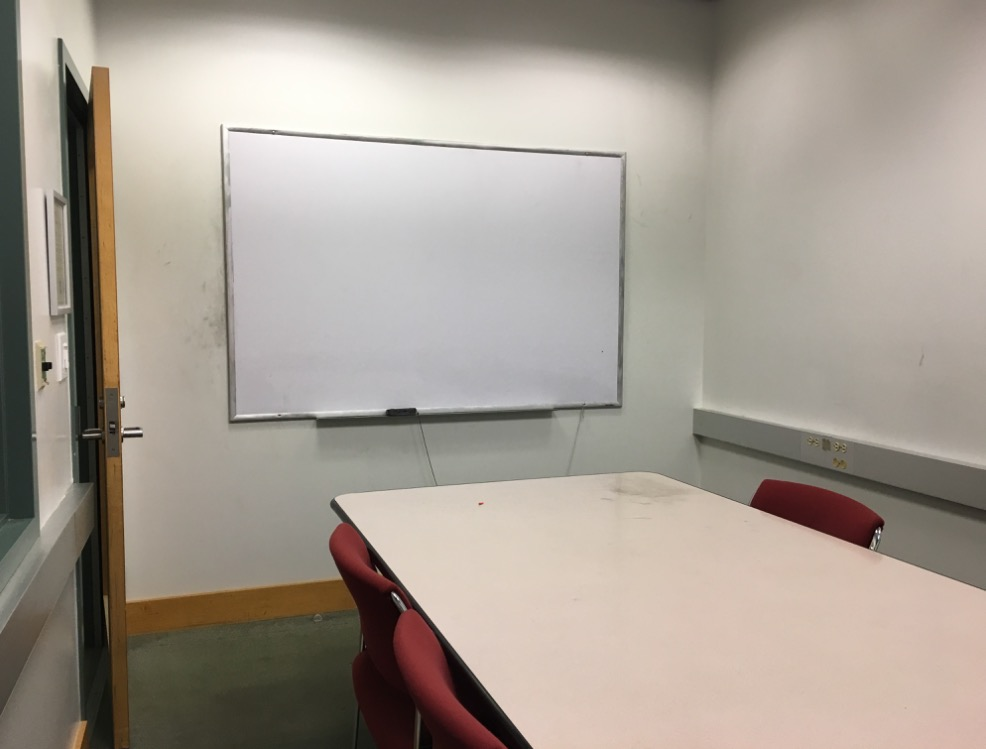 Image of room with table, chairs, and whiteboard