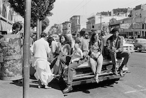 Hippies on car in Haight Ashbury