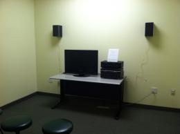 Image of room with chairs, tv screen, and dvd/vhs player