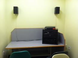 Image of room with chairs and cd player