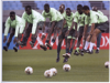 """Nigerian players warm up"" By Jim Bourg"