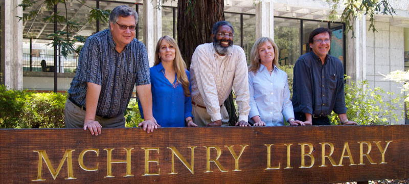 The Undergraduate Experience team in front of McHenry library sign