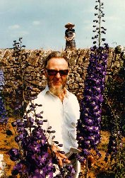 Arnold Fawkus with delphiniums